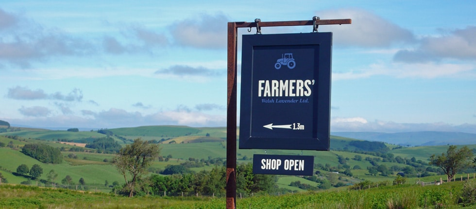 Road sign to the FARMERS' shop