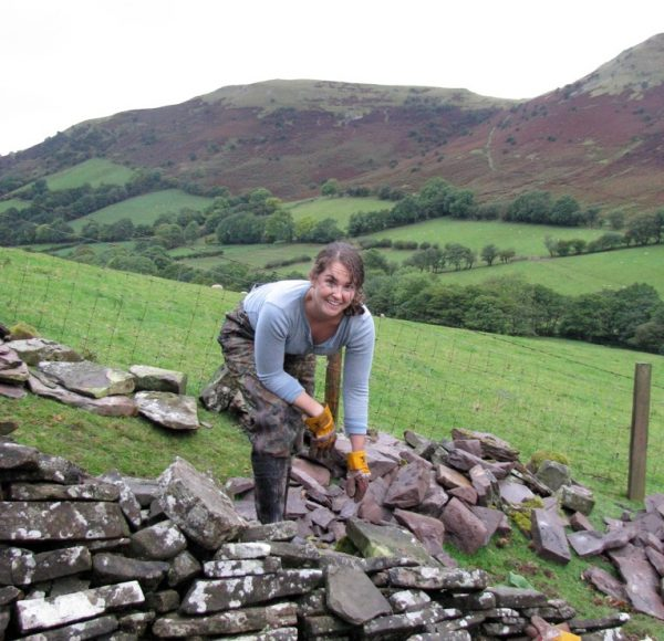 Whitney Brown at work stone walling
